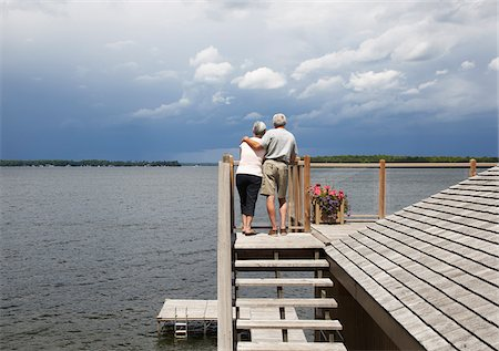 Couple Looking over Lake from Deck Stock Photo - Premium Royalty-Free, Code: 600-01606201