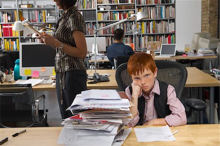 Boy Working in Office Stock Photo - Premium Royalty-Free, Code: 600-01606429