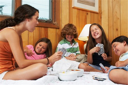 red hair preteen girl - Kids Playing Card Games Stock Photo - Premium Royalty-Free, Code: 600-01606773