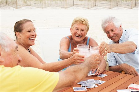 Friends Playing Cards Stock Photo - Premium Royalty-Free, Code: 600-01606825