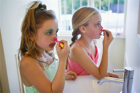 Girls Applying Clown Make-up Stock Photo - Premium Royalty-Free, Code: 600-01603927