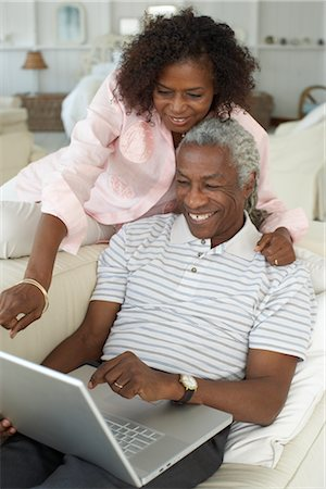 Couple Using Laptop Computer Stock Photo - Premium Royalty-Free, Code: 600-01614039