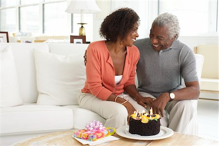 Couple With Birthday Cake Stock Photo - Premium Royalty-Free, Code: 600-01614056
