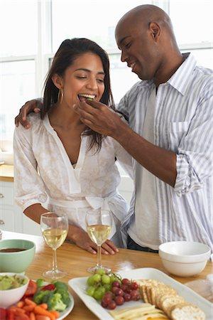 Portrait of Couple Eating Stock Photo - Premium Royalty-Free, Code: 600-01614092
