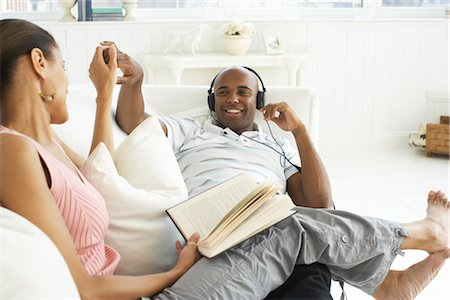 Couple Relaxing on Sofa Stock Photo - Premium Royalty-Free, Code: 600-01614120