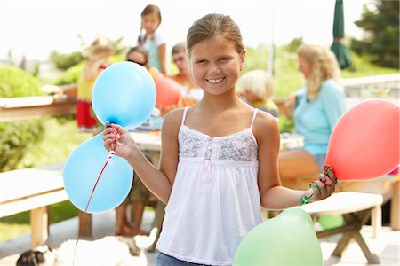 Girl at Birthday Party Holding Balloons Stock Photo - Premium Royalty-Free, Code: 600-01614161