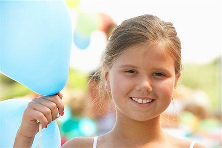 Girl Holding Balloon Stock Photo - Premium Royalty-Free, Code: 600-01614162