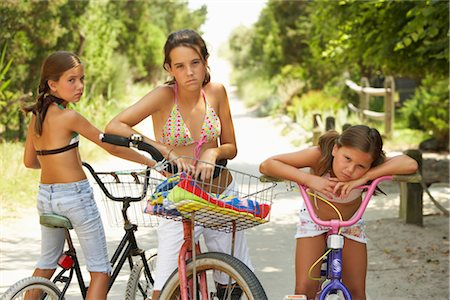 Girls Riding Bicycles Stock Photo - Premium Royalty-Free, Code: 600-01614174