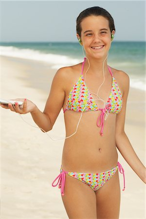 Girl on Beach With Mp3 Player Stock Photo - Premium Royalty-Free, Code: 600-01614175