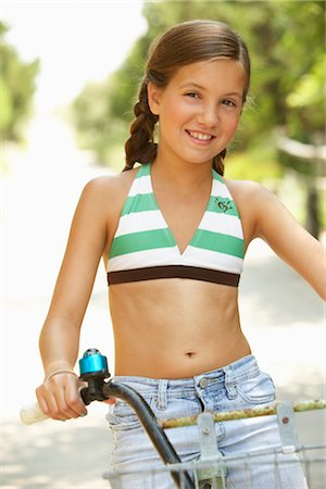 Girl Riding Bicycle Stock Photo - Premium Royalty-Free, Code: 600-01614176
