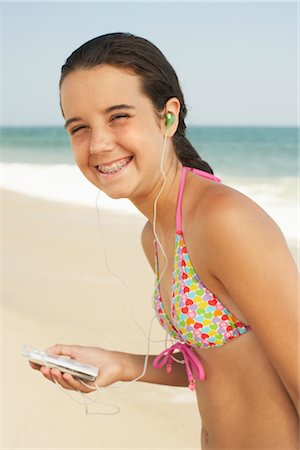 Girl on Beach With Mp3 Player Stock Photo - Premium Royalty-Free, Code: 600-01614177