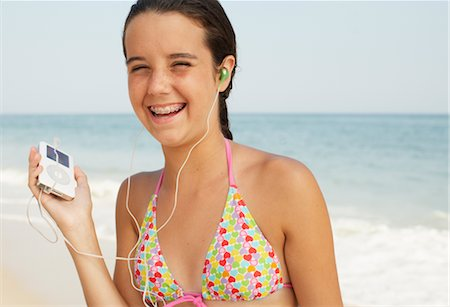 Girl on Beach With Mp3 Player Stock Photo - Premium Royalty-Free, Code: 600-01614178