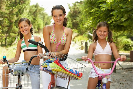 Girls Riding Bicycles Stock Photo - Premium Royalty-Free, Code: 600-01614179