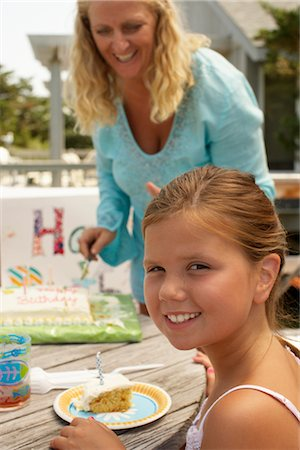 Little Girl at Birthday Party Stock Photo - Premium Royalty-Free, Code: 600-01614172