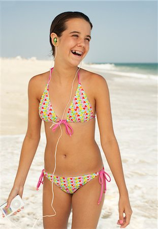 Girl on Beach With Mp3 Player Stock Photo - Premium Royalty-Free, Code: 600-01614184