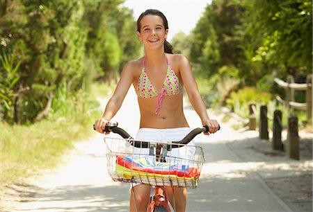 Girl Riding Bicycle Stock Photo - Premium Royalty-Free, Code: 600-01614186