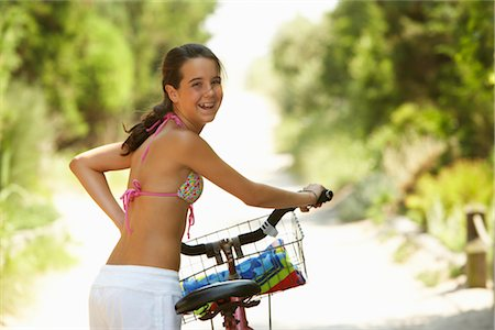 Girl Riding Bicycle Stock Photo - Premium Royalty-Free, Code: 600-01614187