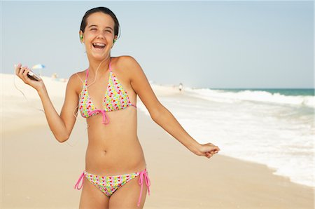 Girl on Beach With Mp3 Player Stock Photo - Premium Royalty-Free, Code: 600-01614188