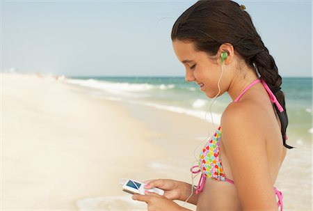 Girl on Beach With Mp3 Player Stock Photo - Premium Royalty-Free, Code: 600-01614180