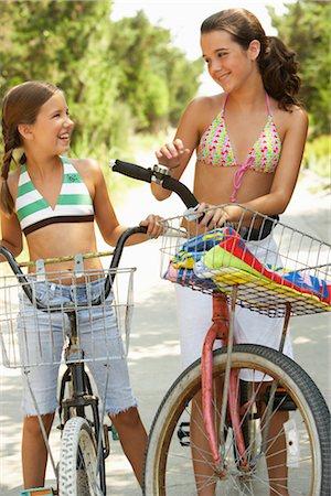 Girls Riding Bicycles Stock Photo - Premium Royalty-Free, Code: 600-01614181