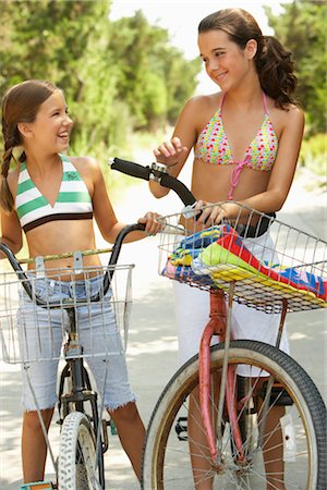 Girls Riding Bicycles Stock Photo - Premium Royalty-Free, Code: 600-01614181
