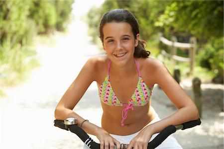 Girl Riding Bicycle Stock Photo - Premium Royalty-Free, Code: 600-01614182