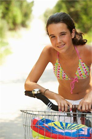 Girl Riding Bicycle Stock Photo - Premium Royalty-Free, Code: 600-01614183