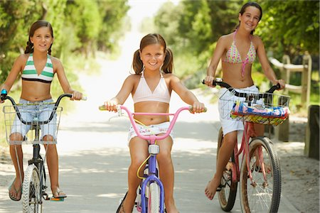 Girls Riding Bicycles Stock Photo - Premium Royalty-Free, Code: 600-01614198