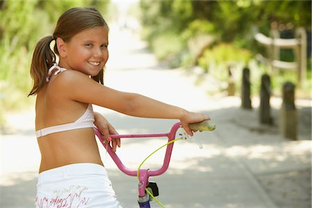 Girl Riding Bicycle Stock Photo - Premium Royalty-Free, Code: 600-01614199