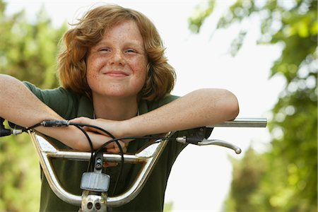 Boy Riding Bicycle Stock Photo - Premium Royalty-Free, Code: 600-01614205