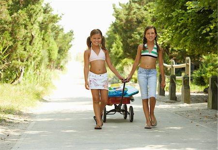 Girls Pulling Wagon Stock Photo - Premium Royalty-Free, Code: 600-01614208
