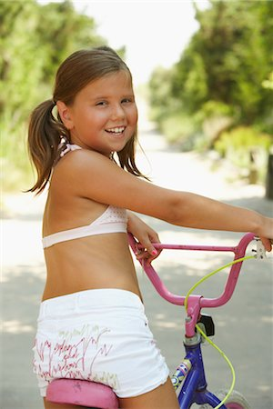 Girl Riding Bicycle Stock Photo - Premium Royalty-Free, Code: 600-01614200