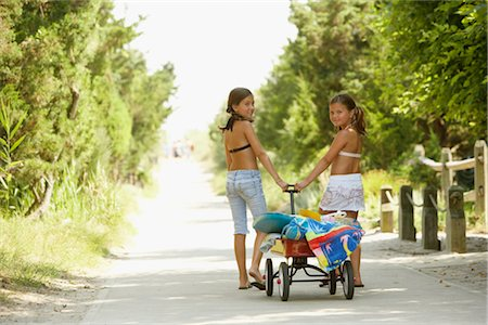Girls Pulling Wagon Stock Photo - Premium Royalty-Free, Code: 600-01614210