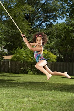 Girl Swinging on Rope Stock Photo - Premium Royalty-Free, Code: 600-01614229