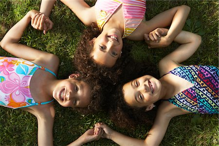 Portrait of Children Laying on Grass Stock Photo - Premium Royalty-Free, Code: 600-01614284
