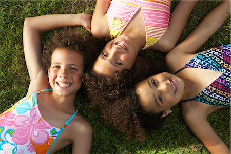 Portrait of children laying on grass Stock Photo - Premium Royalty-Free, Code: 600-01614283
