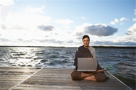 Woman Using Laptop on Dock Stock Photo - Premium Royalty-Free, Code: 600-01614826