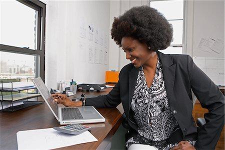 Portrait of businesswoman using laptop Stock Photo - Premium Royalty-Free, Code: 600-01614919