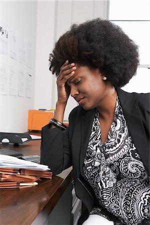 Businesswoman with Headache Stock Photo - Premium Royalty-Free, Code: 600-01614925