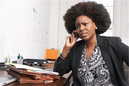 Businesswoman Using Cell Phone Stock Photo - Premium Royalty-Free, Code: 600-01614927
