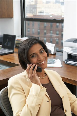 Businesswoman with Cellular Phone Stock Photo - Premium Royalty-Free, Code: 600-01615018