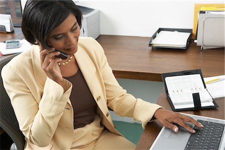 secretary desk - Businesswoman with Cellular Phone and Laptop Computer Stock Photo - Premium Royalty-Free, Code: 600-01615019