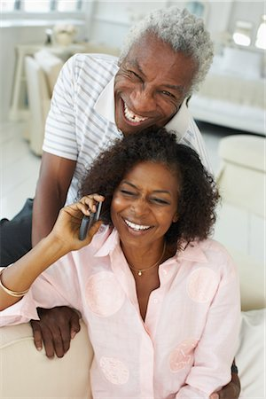 Couple using cell phone together Stock Photo - Premium Royalty-Free, Code: 600-01615051