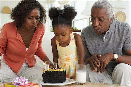 Family celebrating birthday Stock Photo - Premium Royalty-Free, Code: 600-01615053
