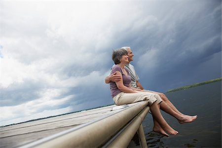 Couple Sitting on Dock Stock Photo - Premium Royalty-Free, Code: 600-01615220