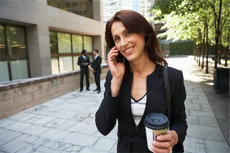 Businesswoman Talking on Cellular Phone Stock Photo - Premium Royalty-Free, Code: 600-01615253