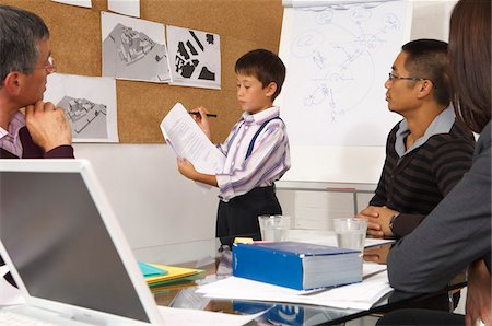 Child Leading Presentation in Office Stock Photo - Premium Royalty-Free, Code: 600-01616434