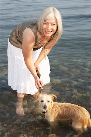Woman With Dog in Water Stock Photo - Premium Royalty-Free, Code: 600-01616648