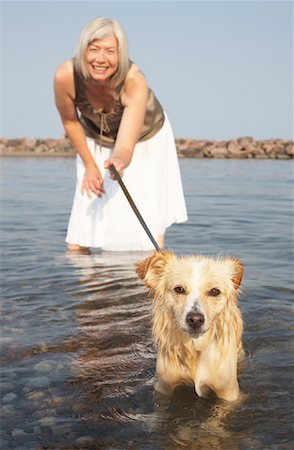 Woman With Dog in Water Stock Photo - Premium Royalty-Free, Code: 600-01616649
