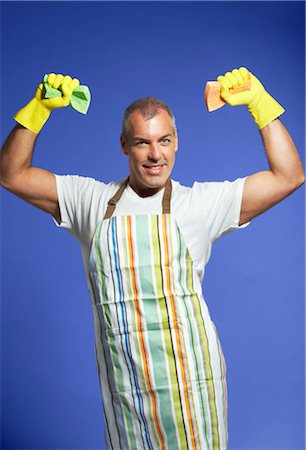 Portrait of Man in Apron, Holding Sponges Stock Photo - Premium Royalty-Free, Code: 600-01613464